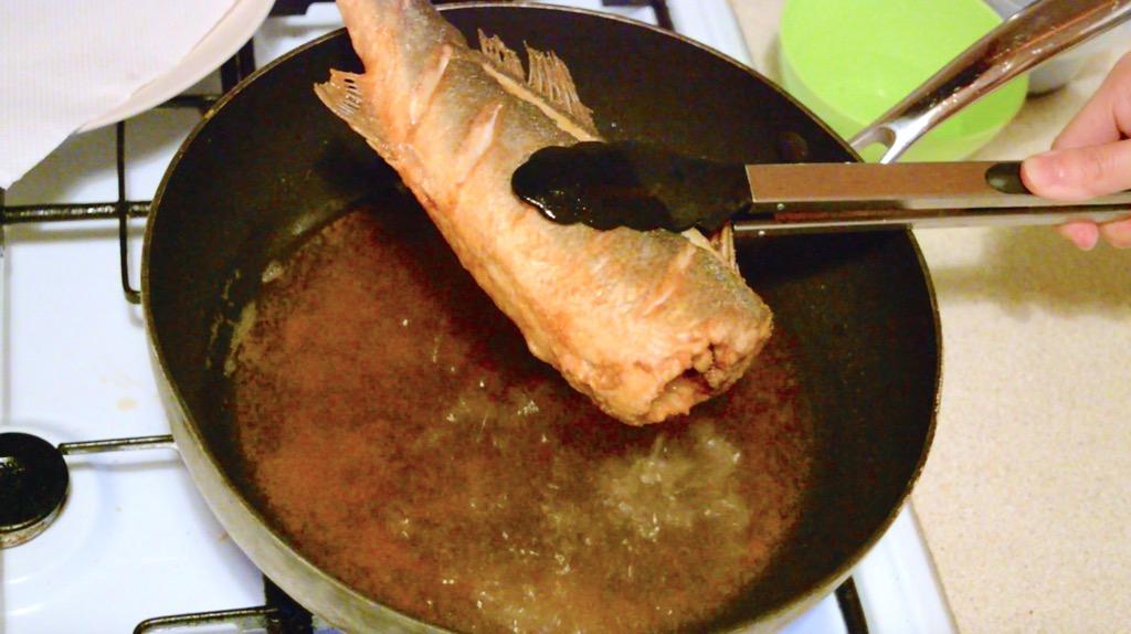deep frying the sea bass