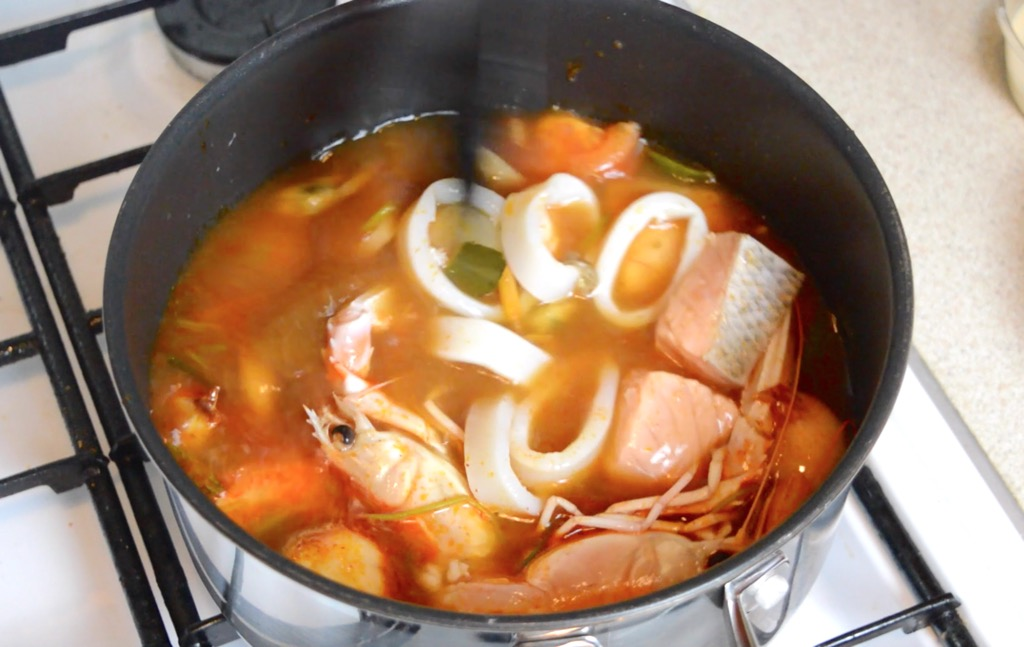 adding seafood to the tom yum