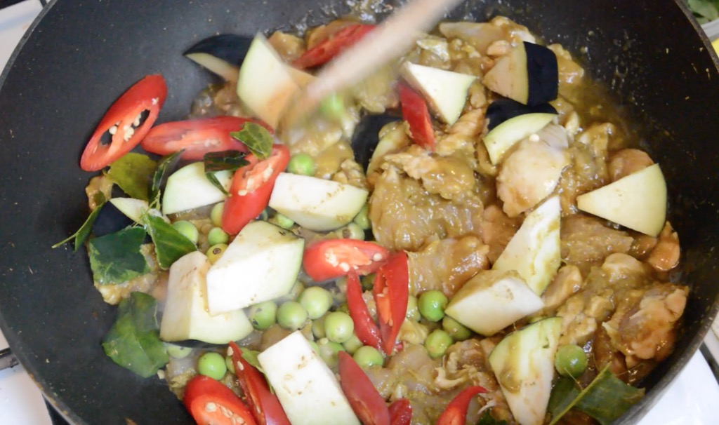adding eggplant to green curry