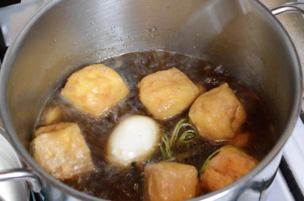 adding tofu to the soup broth