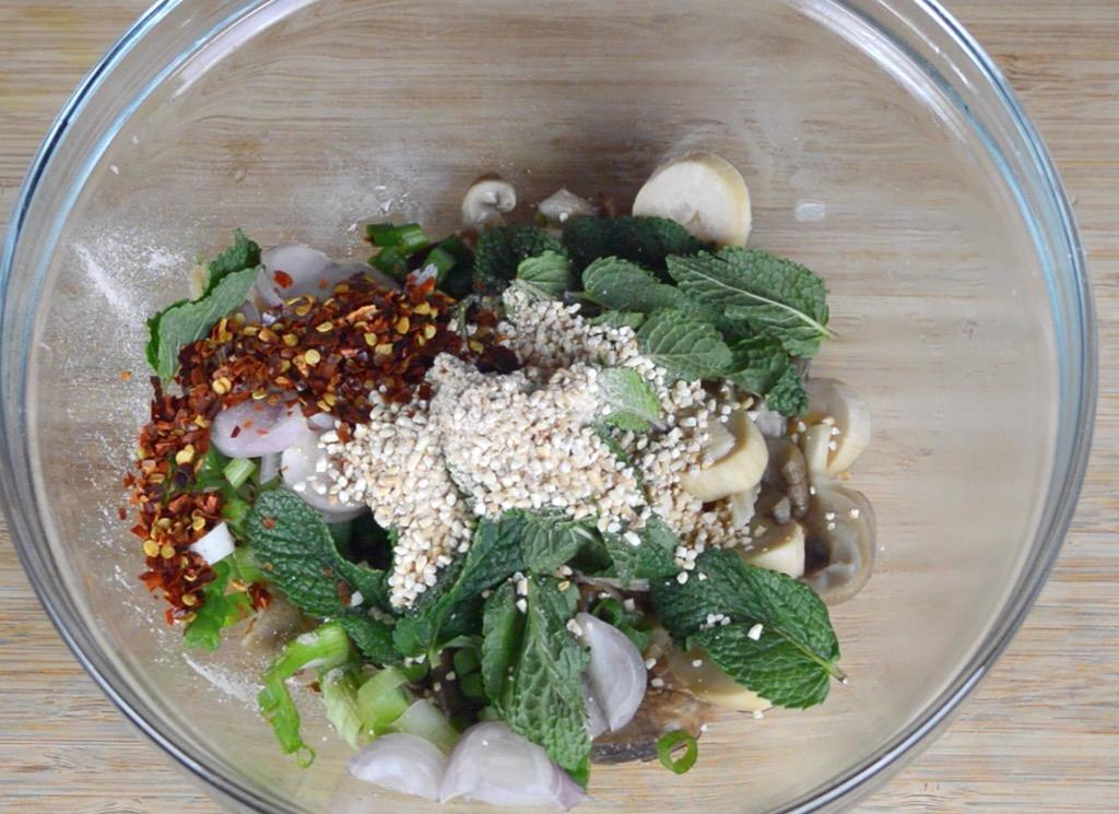 mixing the mushroom laab salad