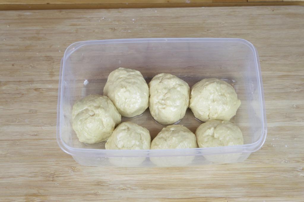 balling up the roti dough