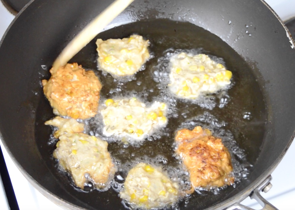 frying the shrimp and corn cakes