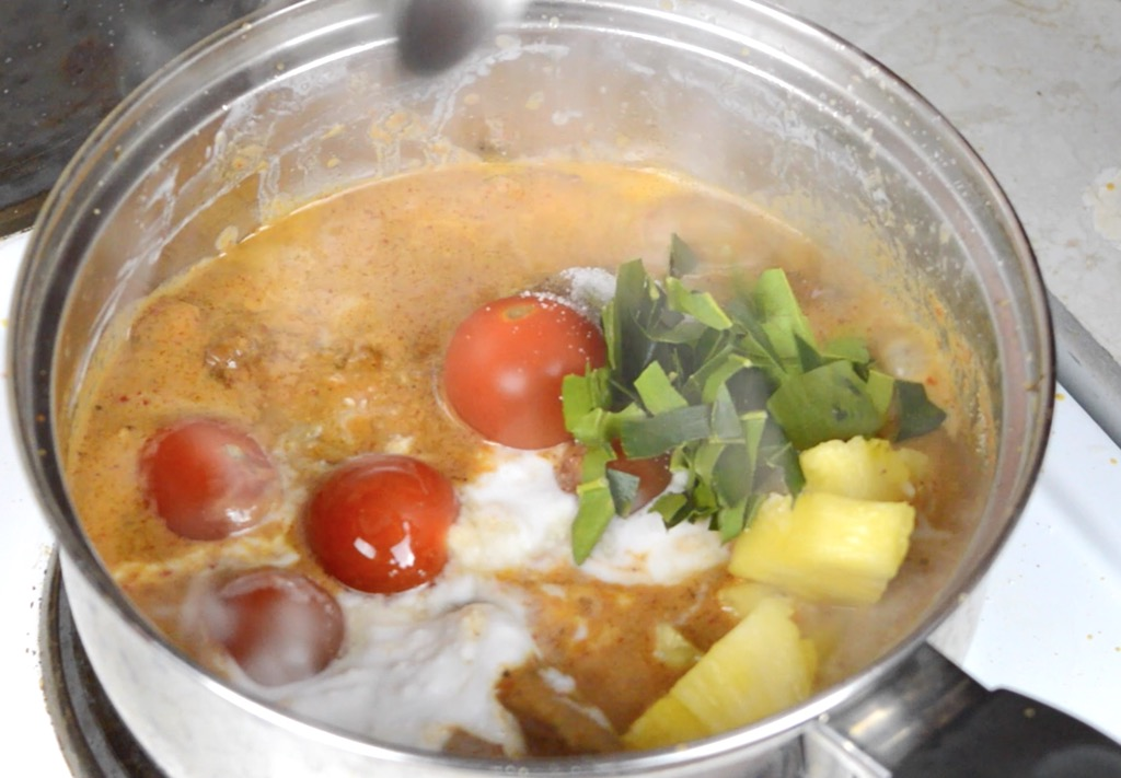 making the thai duck curry